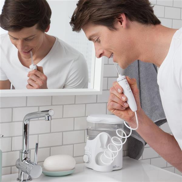 Using WF-06 White Whitening Water Flosser