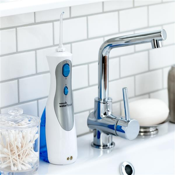 White Cordless Plus Water Flosser WP-450 In Bathroom